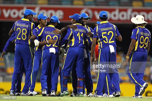 Sri Lanka celebrate winning game eight of the One Day International Series between India and Sri Lanka at The Gabba on February 21, 2012 in Brisbane,...