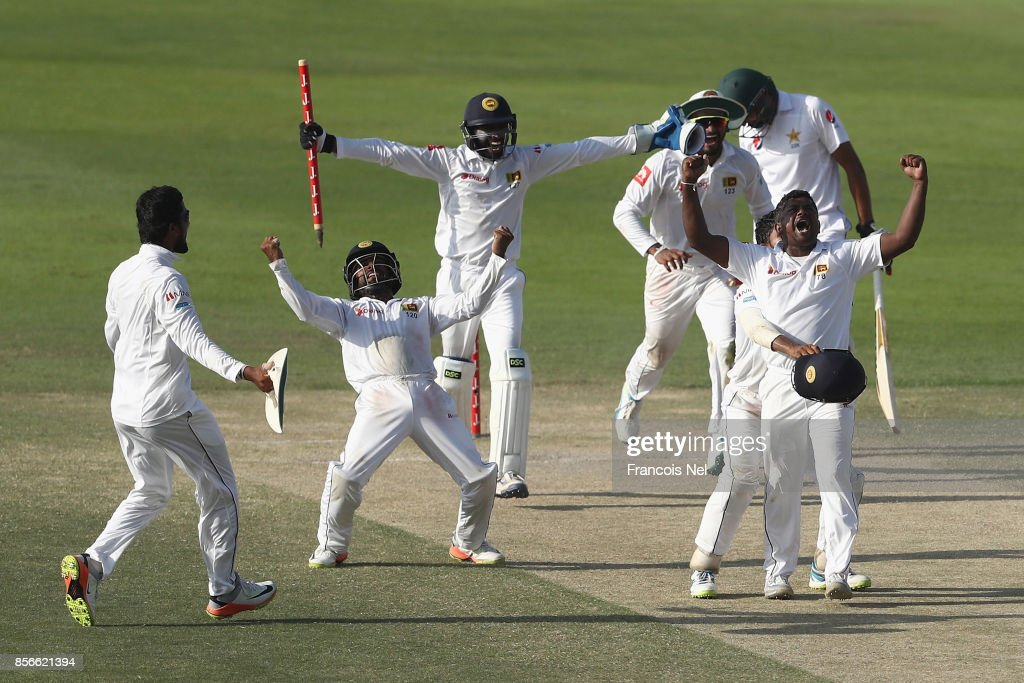 Sri Lanka celebrates taking the final wicket of Mohammad Abbasto win the First Test between Pakistan and Sri Lanka at Sheikh Zayed stadium on October 2, 2017 in Abu Dhabi, United Arab Emirates.