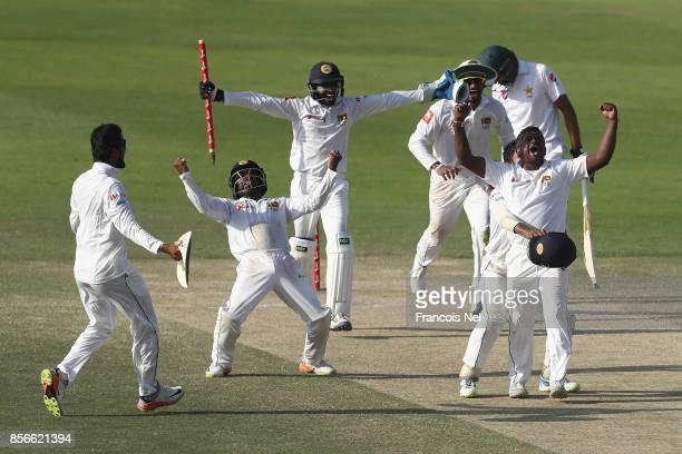 Sri Lanka celebrates taking the final wicket of Mohammad Abbasto win the First Test between Pakistan and Sri Lanka at Sheikh Zayed stadium on October...