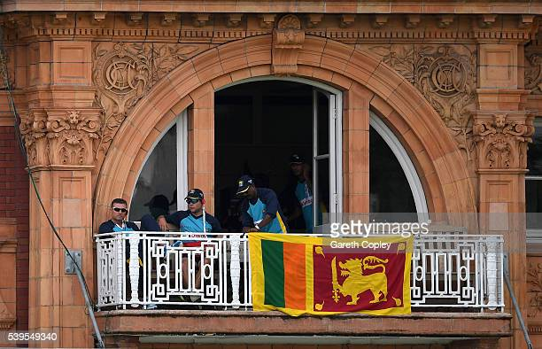 Sri Lanka coaching coaching staff hang their national flag from the players balcony during day four of the 3rd Investec Test match between England...