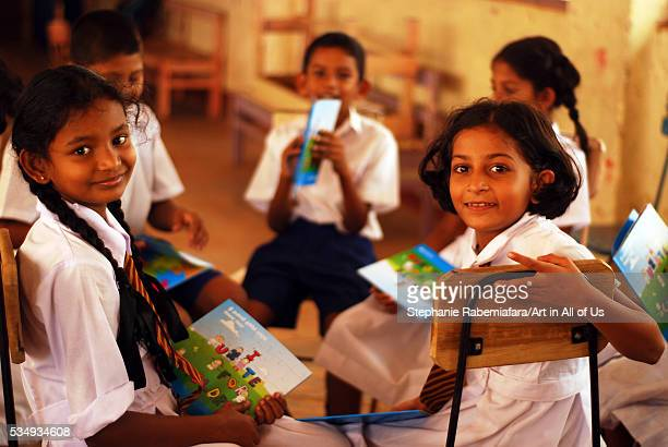 Sri Lanka Colombo children in uniform looking at Unicef children book