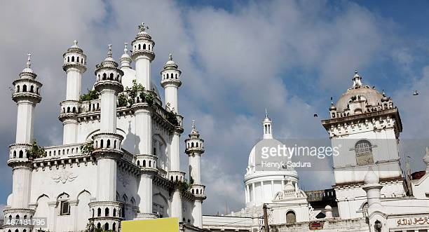 Sri Lanka, Colombo, Devatagaha Mosque and town hall against cloudy sky