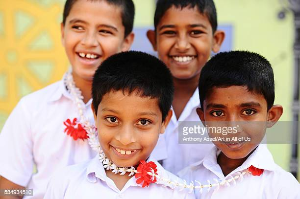 Sri Lanka Colombo group of children posing and smiling in front of camera with flower neckless and in uniform Colombo Sri Lanka