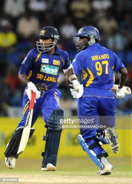 Sri Lanka cricket captain Mahela Jayawardene and teammate Thilina Thushara Mirando run between the wickets during the third One Day International...
