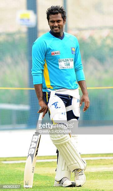 Sri Lanka cricket team captain Angelo Mathews look on during a practice session at the Dubai Sports city in Dubai on January 6 2014 Sri Lanka and...