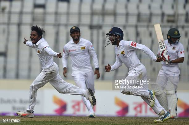 Sri Lanka cricketer Akila Dananjaya celebrates after taking the wicket of the Bangladesh cricketer Mehidy Hasan during the third day of the second...