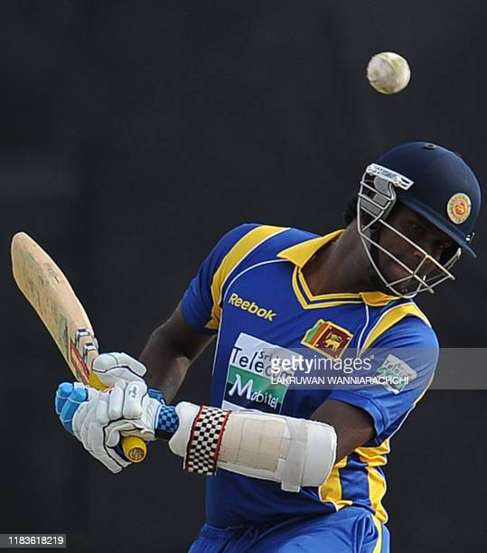 Sri Lanka cricketer Angelo Mathews tries to avoid a bouncer from Australian bowler Doug Bollinger during the second One Day International match...