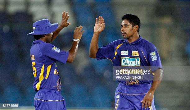 Sri Lanka cricketer Chaminda Vaas celebrates the wicket of Bangladesh cricketer Tamim Iqbal Khan with Chamar Silva during the Super League Asia Cup...