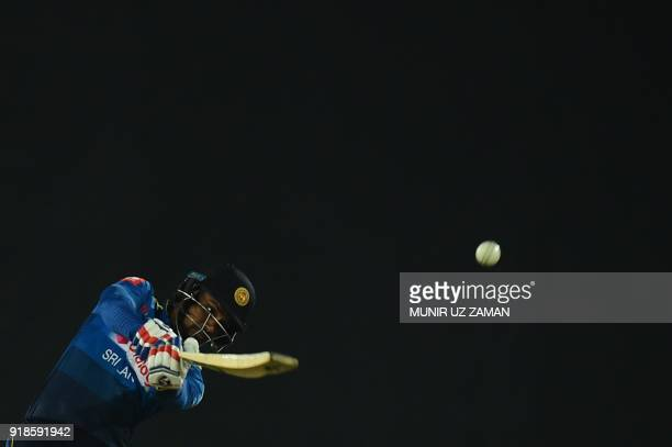 Sri Lanka cricketer Danushka Gunathilaka plays a shot during the first Twenty20 cricket match between Bangladesh and Sri Lanka at the ShereBangla...
