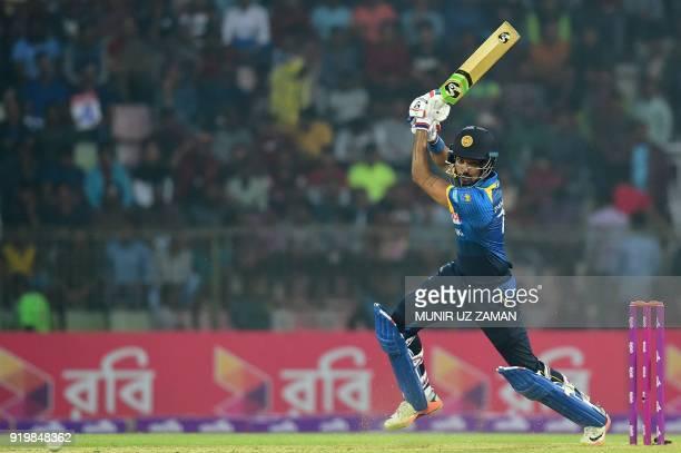 Sri Lanka cricketer Danushka Gunathilaka plays a shot during the second Twenty20 cricket match between Bangladesh and Sri Lanka at the Sylhet...