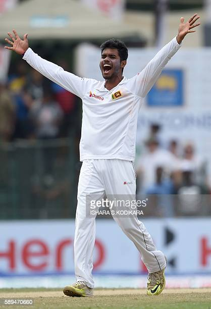 Sri Lanka cricketer Dhananjaya de Silva celebrates after he dismissed Australian cricketer David Warner during the second day of the third and final...