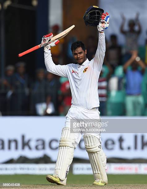 Sri Lanka cricketer Dhananjaya de Silva celebrates making a century during the first day of the third and final Test cricket match between Sri Lanka...