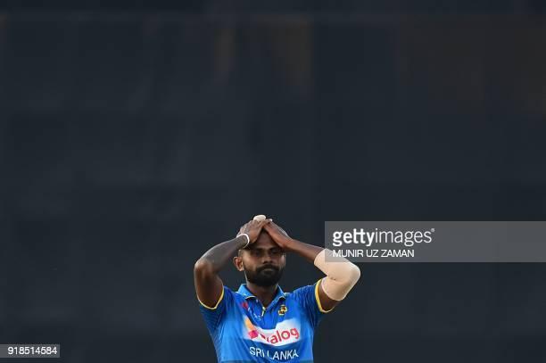 Sri Lanka cricketer Isuru Udana reacts following a miss field during the first Twenty20 cricket match between Bangladesh and Sri Lanka at the...