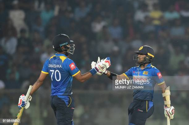 Sri Lanka cricketer Kusal Mendis celebrates with his teammate Danushka Gunathilaka after scoring a half century during the second Twenty20 cricket...