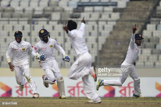Sri Lanka cricketer Kusal Mendis celebrates with his teammates after the dismissal of the Bangladesh cricketer Sabbir Rahman as his teammate...