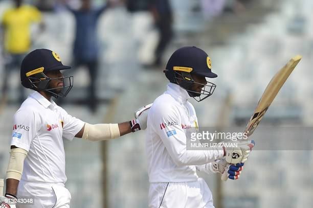 Sri Lanka cricketer Kusal Mendis console his teammate Dhananjaya de Silva as he walk off the field after being dismissed by Bangladesh cricketer...
