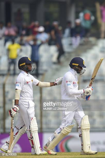 Sri Lanka cricketer Kusal Mendis consoles his teammate Dhananjaya de Silva as he walks off the field after being dismissed by Bangladesh cricketer...