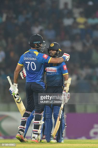 Sri Lanka cricketer Kusal Mendis hugs his teammate Danushka Gunathilaka after scoring a half century during the second Twenty20 cricket match between...
