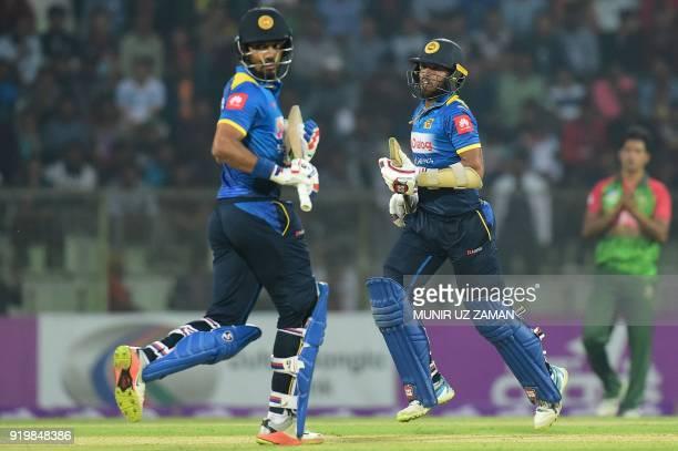 Sri Lanka cricketer Kusal Mendis runs between the wickets with his teammate Danushka Gunathilaka during the second Twenty20 cricket match between...