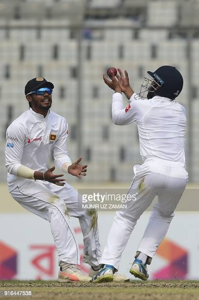 Sri Lanka cricketer Kusal Mendis takes a catch to dismiss Bangladesh cricketer Sabbir Rahman as his teammate Dhananjaya de Silva looks on during the...