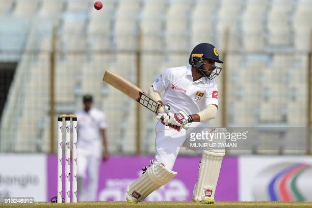 Sri Lanka cricketer Kusal Mendis tries to avoid a bouncer from Bangladesh cricketer Mustafizur Rahman during the third day of the first cricket Test...