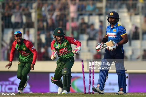 Sri Lanka cricketer Kusal Perera is bowled out by the Bangladesh cricketer Nasir Hossain as his teammate wicketkeeper Mushfiqur Rahim and Sabbir...
