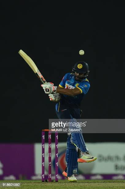 Sri Lanka cricketer Niroshan Dickwella plays a shot during the first Twenty20 cricket match between Bangladesh and Sri Lanka at the ShereBangla...