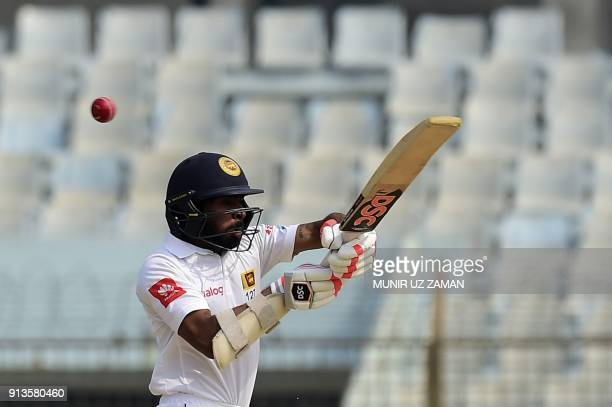 Sri Lanka cricketer Niroshan Dickwella plays a shot during the fourth day of the first cricket Test between Bangladesh and Sri Lanka at Zahur Ahmed...