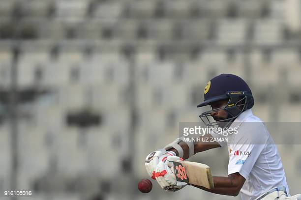 Sri Lanka cricketer Niroshan Dickwella plays a shot during the second day of the second cricket Test between Bangladesh and Sri Lanka at the...