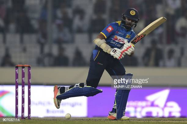 Sri Lanka cricketer Niroshan Dickwella plays a shot during the third one day international cricket match of the TriNations Series between Bangladesh...