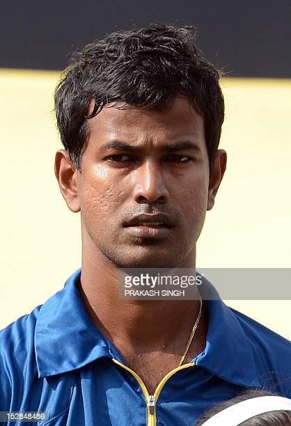 Sri Lanka cricketer Nuwan Kulasekara looks on during the ICC Twenty20 Cricket World Cup's Super Eight match between Sri Lanka and New Zealand at the...