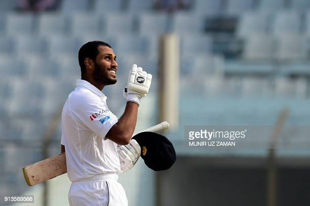 Sri Lanka cricketer Roshen Silva reacts after scoring a century during the fourth day of the first cricket Test between Bangladesh and Sri Lanka at...