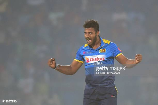 Sri Lanka cricketer Shehan Madushanka celebrates after the dismissal of the Bangladesh cricketer Mushfiqur Rahim during the second Twenty20 cricket...