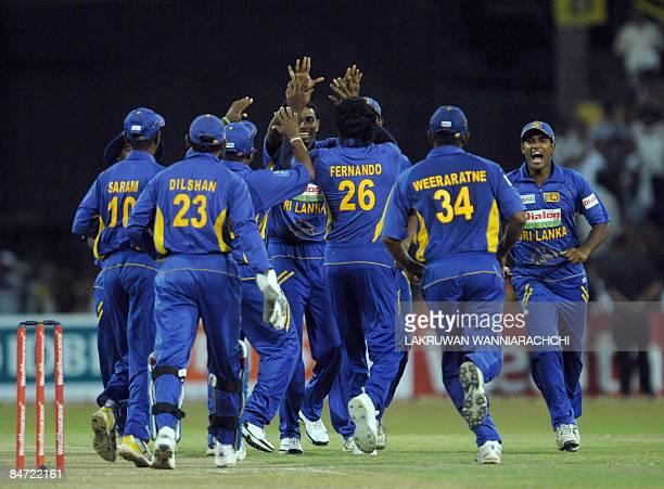 Sri Lanka cricketer Thilina Thushara Mirando celebrates with teammates the dismissal of unseen Indian cricketer Gautam Gambhir during the Twenty20...