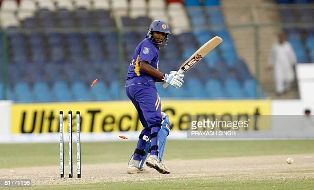 Sri Lanka cricketer Thilina Thushara Mirando watches his bails go in air after being bowled out by Bangladesh's Mashrafe Bin Mortaza during the Super...