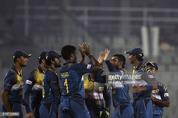 Sri Lanka cricketers celebrate after the dismissal of the Pakistan cricketer Mohammad Hafeez during the Asia Cup T20 cricket tournament match between...