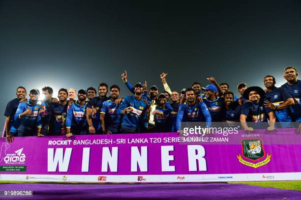 Sri Lanka cricketers pose with the tournament trophy following the presentation ceremony during the end the second Twenty20 cricket match between...