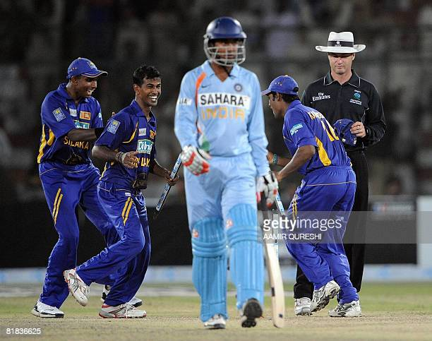 Sri Lanka cricketers Thilina Thushara Mirando Nuwan Kulasekera and Mahela Kapugedera celebrate the victory over India as India cricketer Pragyan Ojha...