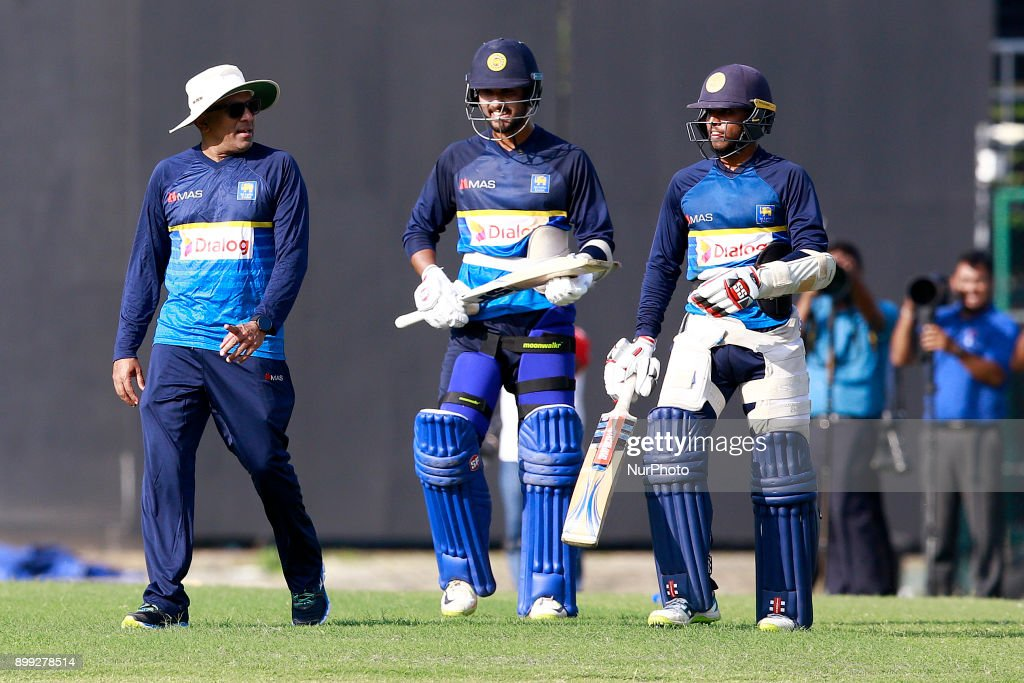 Sri Lanka cricket's new head coach Chandika Hathurusingha(L), Dinesh Chandimal(2L) and Kusal Mendis are seen during a practice session with the Sri Lankan cricketers at R Premadasa cricket stadium, Colombo, Sri Lanka on Thursday 28 December 2017. Sri Lanka will be leaving to Bangladesh on Saturday, 13th January to take part in a Tri-Nation One Day International cricket Tournament with Bangladesh and Zimbabwe followed by two test matches and two Twenty-20 matches against Bangladesh.