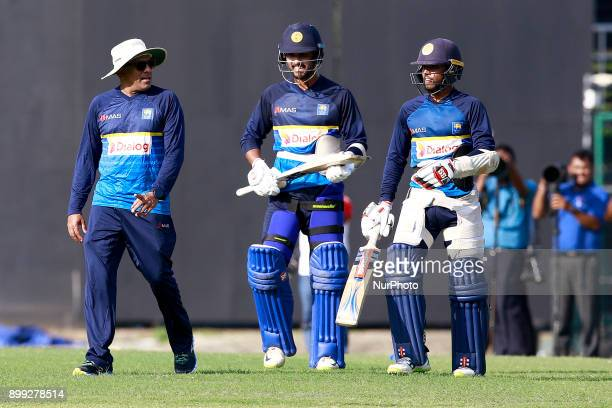 Sri Lanka cricket's new head coach Chandika Hathurusingha Dinesh Chandimal and Kusal Mendis are seen during a practice session with the Sri Lankan...