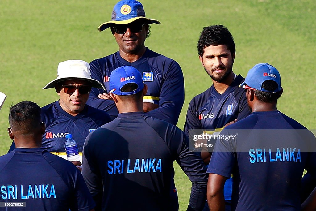 Sri Lanka cricket's new head coach Chandika Hathurusingha(2L, wearing a white hat and sunglasses), Sri Lanka cricket's new fast bowling coach Rumesh Ratnayake(3L) and Sri Lanka cricket's captain Dinesh Chndimal are seen during a practice session with the Sri Lankan cricketers at R Premadasa cricket stadium, Colombo, Sri Lanka on Thursday 28 December 2017. Sri Lanka will be leaving to Bangladesh on Saturday, 13th January to take part in a Tri-Nation One Day International cricket Tournament with Bangladesh and Zimbabwe followed by two test matches and two Twenty-20 matches against Bangladesh.