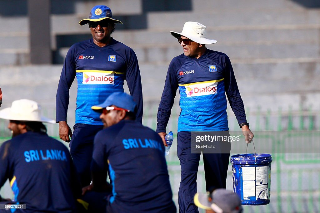 Sri Lanka cricket's new head coach Chandika Hathurusingha(2L) walks off carrying a basket filled with cricket balls with Sri Lanka cricket's new fast bowling coach Rumesh Ratnayake after a practice session with the Sri Lankan cricketers at R Premadasa cricket stadium, Colombo, Sri Lanka on Thursday 28 December 2017. Sri Lanka will be leaving to Bangladesh on Saturday, 13th January to take part in a Tri-Nation One Day International cricket Tournament with Bangladesh and Zimbabwe followed by two test matches and two Twenty-20 matches against Bangladesh.