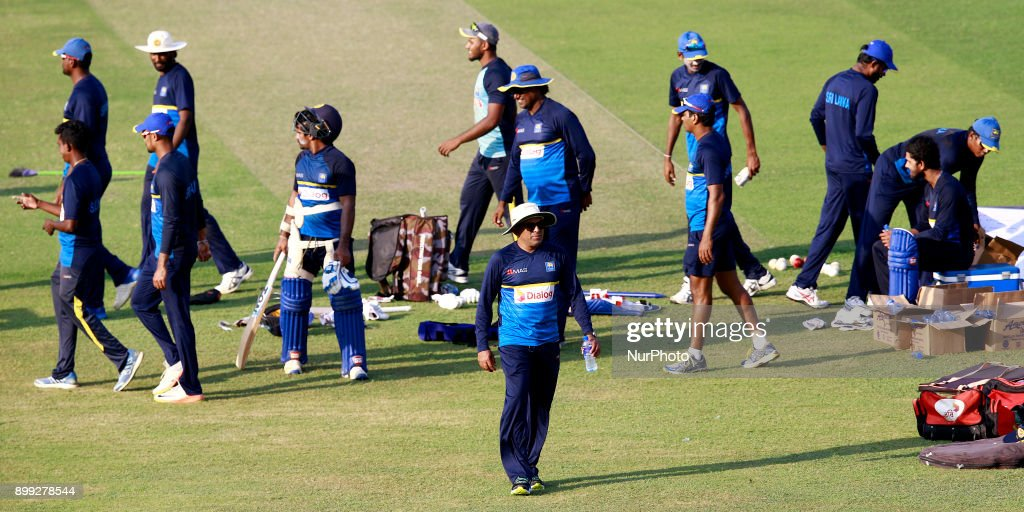 Sri Lanka cricket's new head coach Chandika Hathurusingha (center,wearing a white hat and sunglasses) walks off the field after a practice session with the Sri Lankan cricketers at R Premadasa cricket stadium, Colombo, Sri Lanka on Thursday 28 December 2017. Sri Lanka will be leaving to Bangladesh on Saturday, 13th January to take part in a Tri-Nation One Day International cricket Tournament with Bangladesh and Zimbabwe followed by two test matches and two Twenty-20 matches against Bangladesh.