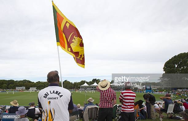 A Sri Lanka fan holds a national flag during day two of the first International Test cricket match between New Zealand and Sri Lanka at Hagley Park...