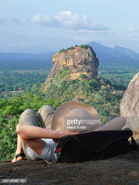 sri lanka, female tourist facing the citadel of sigiriya, rear view - sigiriya stock photos and pictures