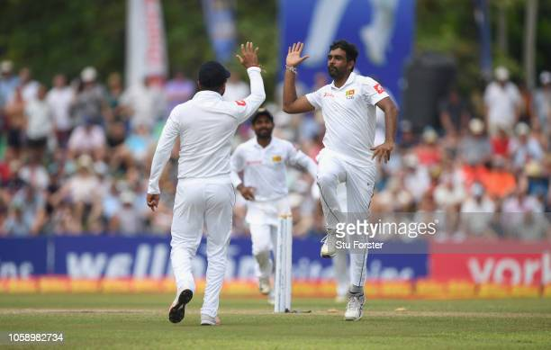 Sri Lanka fielder Dilruwan Perera congratulates Dimuth Karunaratne after he had ran out Rory Burns during Day three of the First Test match between...