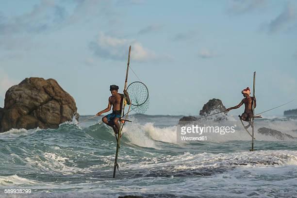 sri lanka, galle, stilt fishermen - ゴール市 ストックフォトと画像