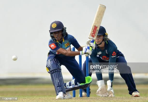 Sri Lanka Harshitha Madavi plays a shot as England's wicketkeeper Amy Jones looks on during the oneday practice cricket match between the Sri Lanka...