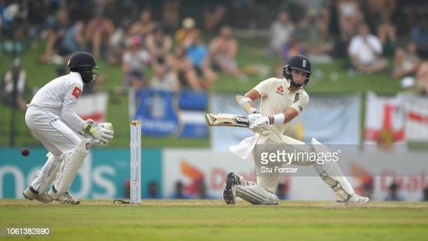 Sri Lanka keeper Niroshan Dickwella looks on as Sam Curran hits out during Day One of the Second Test match between Sri Lanka and England at...