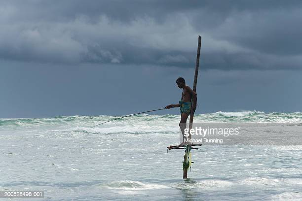 Sri Lanka, man fishing in sea